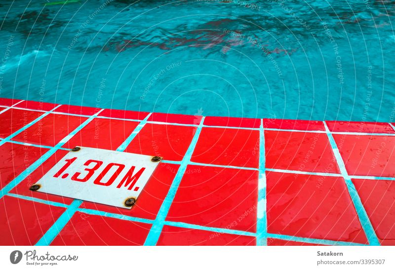 Deep level sign on the border of swimming pool water mark deep number indicator meter depth outdoors surface blue tile red Swimming pool Surface of water