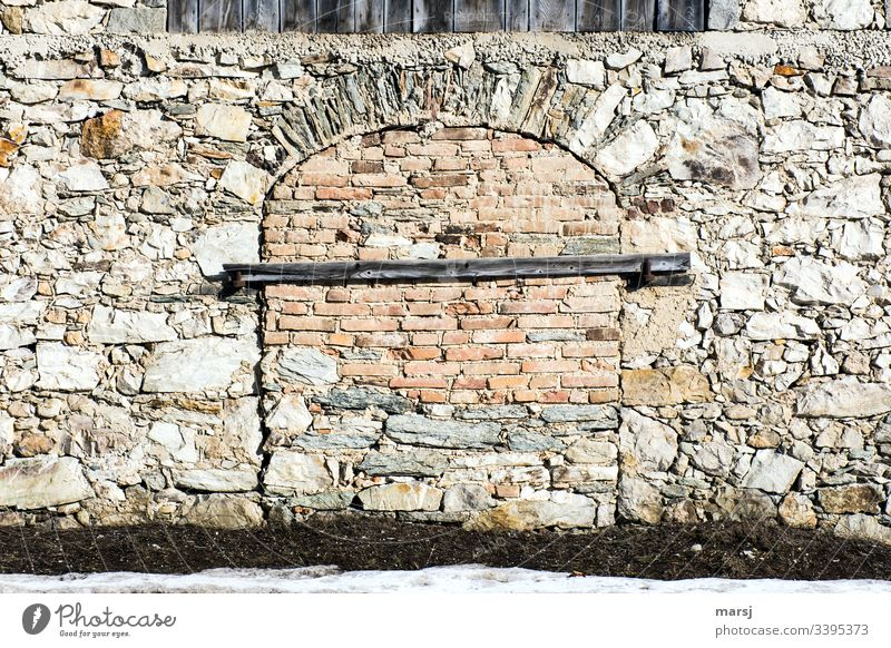 A stone wall with a walled gate, which is additionally secured with a beam. Expertly bricked archway. Stone wall Wall (barrier) Archway Door protection