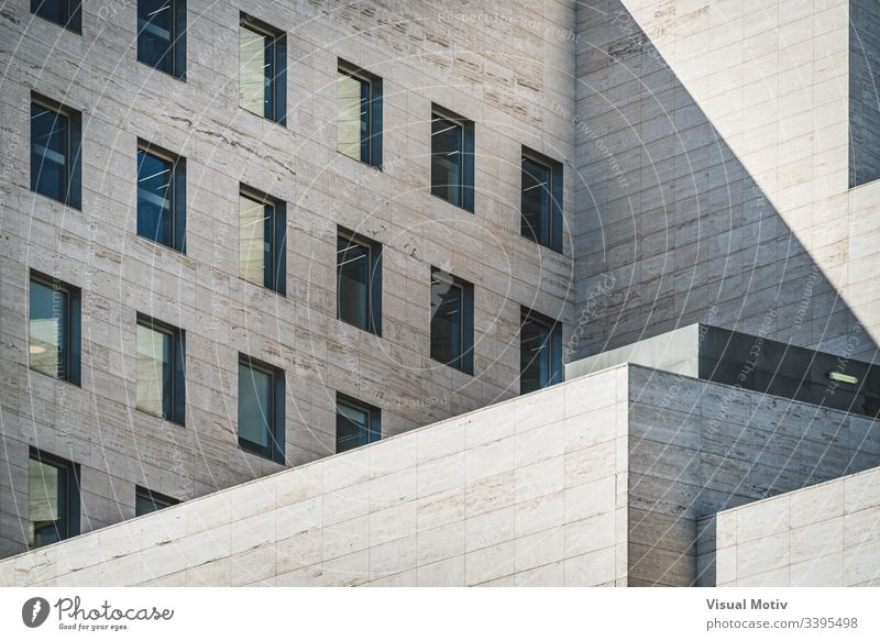 Architectural geometry view of a business building built in roman travertine marble abstract abstract background abstract photography afternoon architectonic
