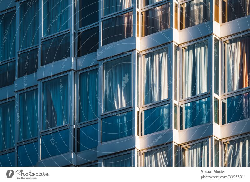 Eclectic glazed facade of an urban building urban facade Architecture structure windows glazed windows no people eclectic abstract background building facade