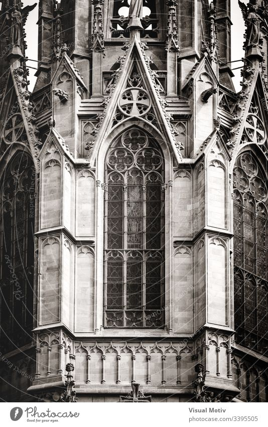 Sculpted filigrees of a gothic cathedral main tower in black and white architecture gothic style basilica outdoors exterior architectural detail built structure