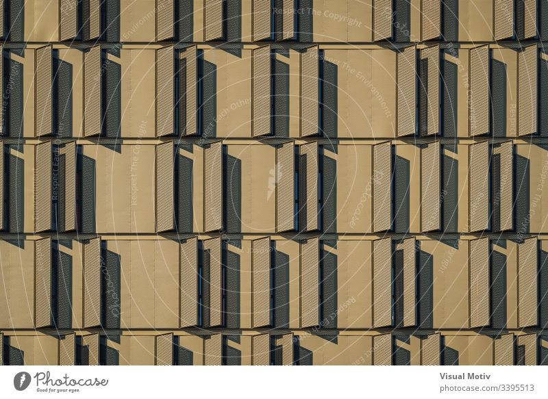 Modern building facade full of window shutters urban facade Architecture structure windows no people eclectic abstract background building design metropolitan