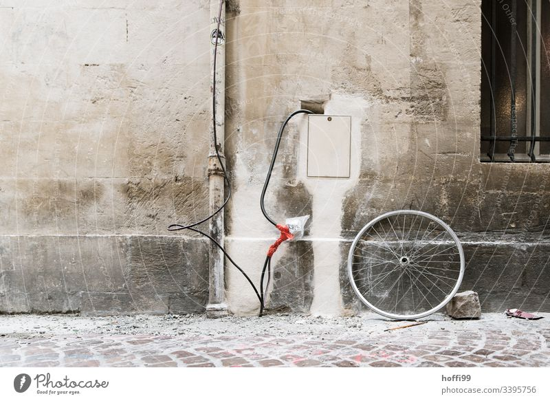 creative electrical installation / creative house connection at an old building with stone and bicycle rim Electrical equipment Electronics Dirty streams