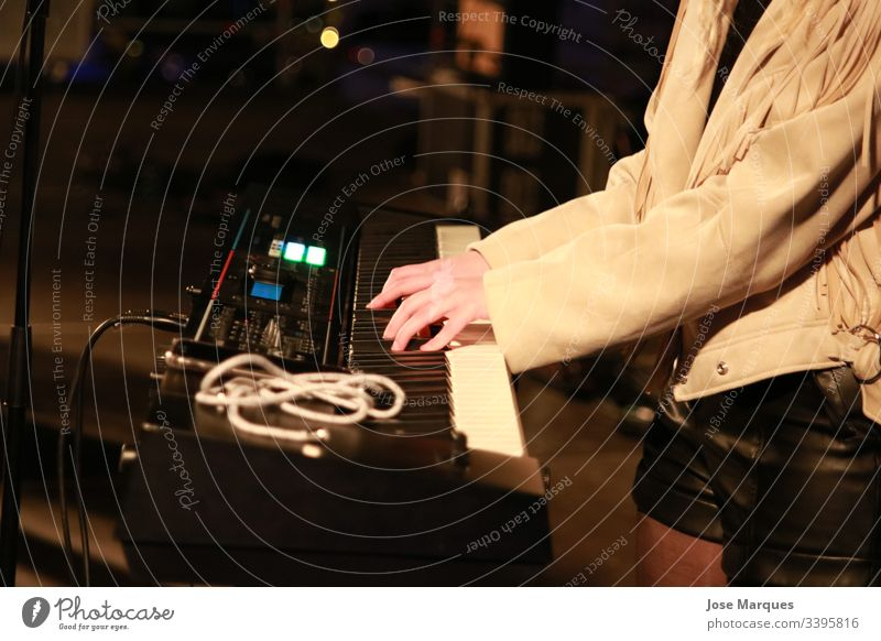pianist at a music concert Piano Girl Hands Music Play piano Interior shot Musical instrument Art Musician Human being Show Concert Keyboard Playing Detail