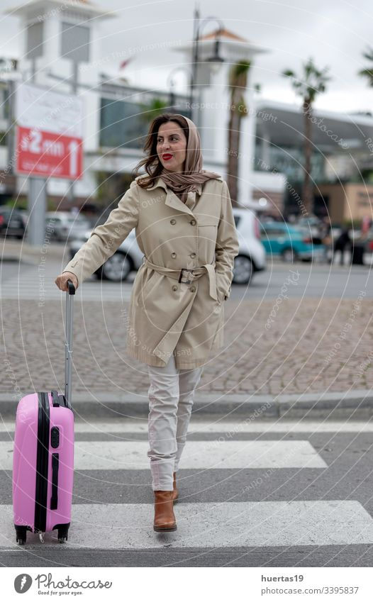 Attractive Arab woman with hijab and suitcase female attractive muslim muslim woman mobile phone arab baggage travel: islamic traveler arabian arabic trip