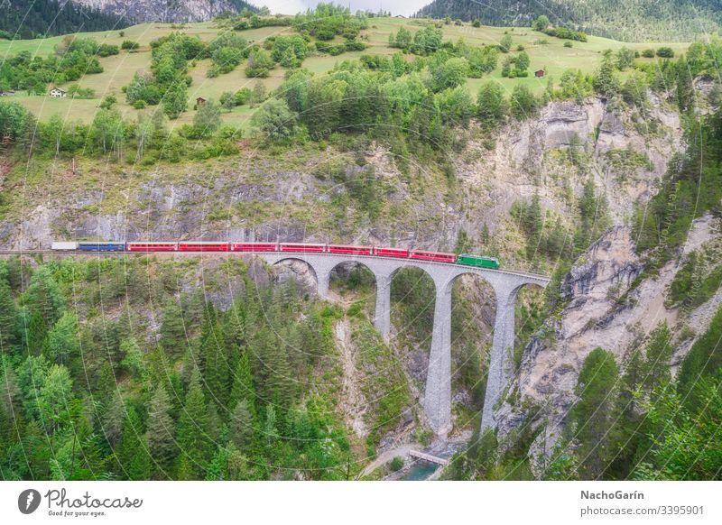 Red express train runs on famous Landwasser bridge in Filisur, the heart of Alpine mountains in Switzerland landwasser swiss switzerland nature architecture