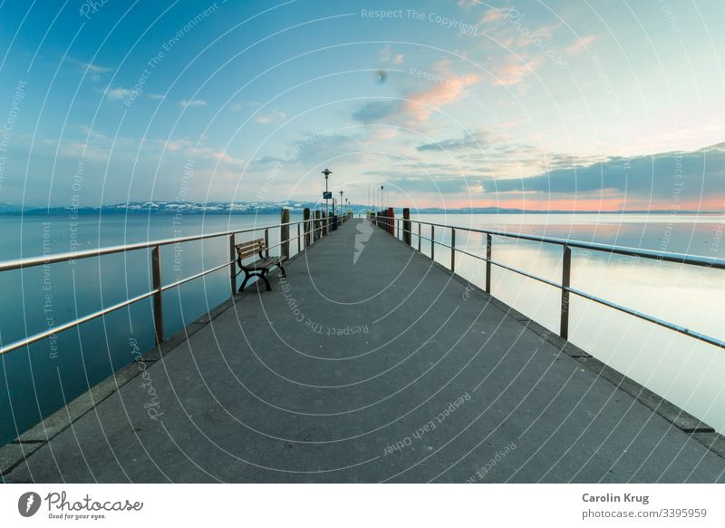 Recording of a landing stage at Lake Constance at dusk. Even with clear paths, sometimes it remains uncertain for all of us where they will lead us. Dusk