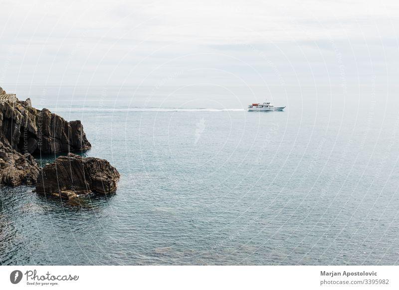 Beautiful seascape with ship going to the sea aerial bay beautiful blue boat cliff coast coastal coastline cruise destination europe harbor holiday horizon