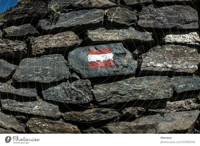 Flag navigation Austria alpine crossing Hiking Stone wall flag trail Alps long-distance hiking trail Adventure Mountain Orientation Sign Colour Reddish white