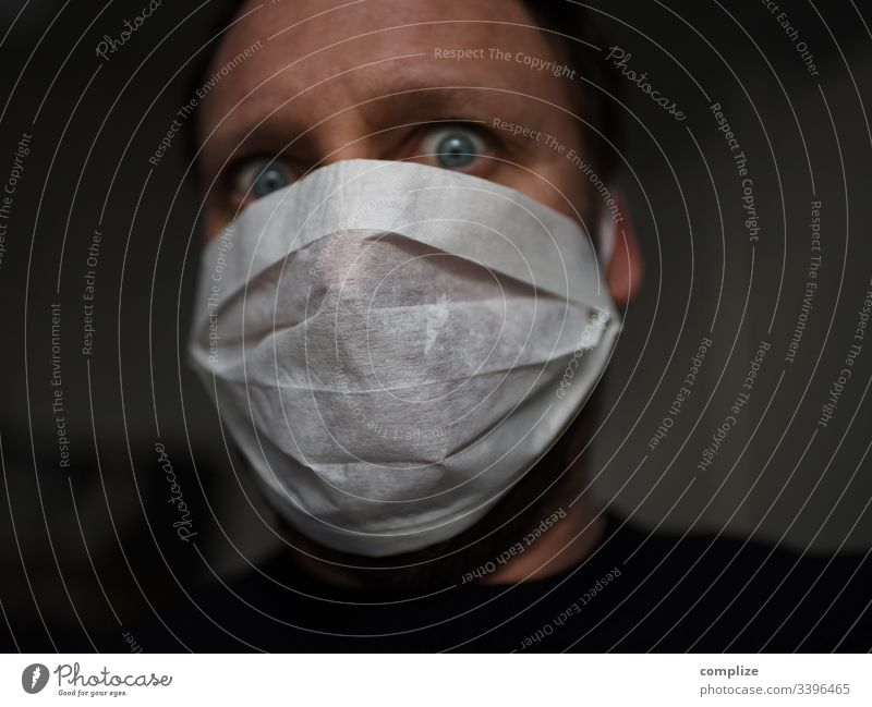 Fear of the virus | man with mouth guard corona Virus coronavirus flu Mask medicine Influenza flu virus Infection peril epedemi Epidemic risk of contagion
