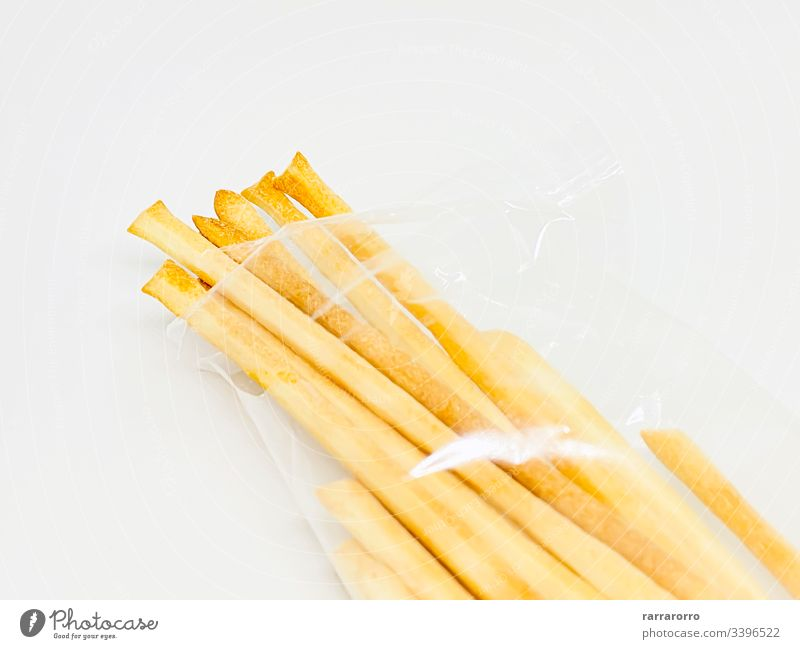 A group of Italian breadsticks isolated on a white background food snack bread stick bread sticks appetizer italian baked delicious fresh meal cuisine closeup
