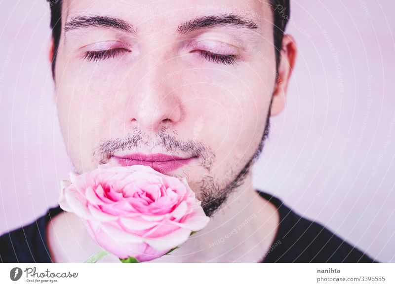 Portrait of new masculinity about a man with make up makeup male beauty gender trans transgender people real real people rose pink color flower delicate fragile