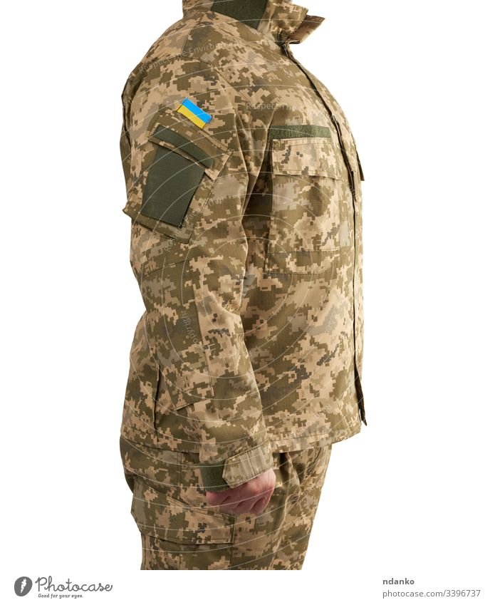 Ukrainian man warrior dressed in a military pixel uniform stands on a white isolated background flag ukraine ukrainian soldier army camouflage force male combat