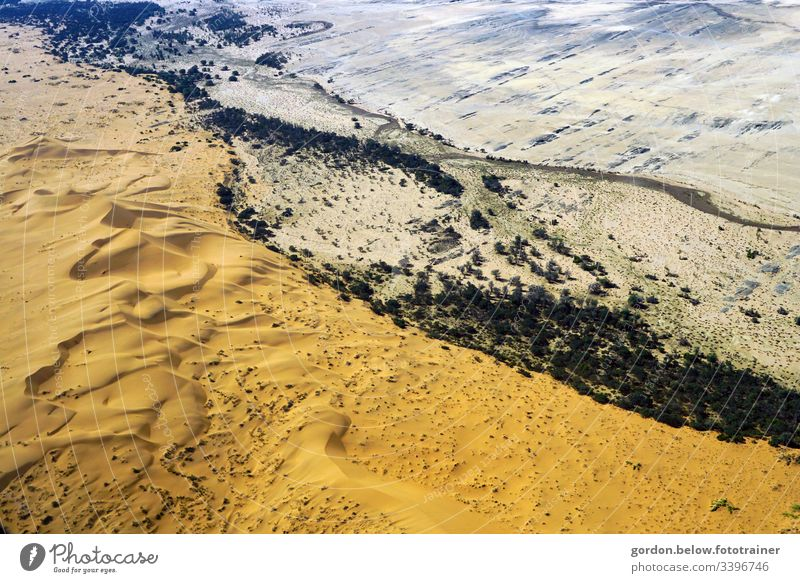 Desert Namibia formed by the wind! Colour photo day recording Deserted free surfaces Bird's-eye view Brown tones Light and shadow Vacation & Travel Freedom Sky