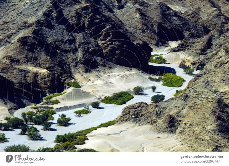 #Namibia: Oasis in the desert Rock of sandstone Fine sand in the valley sparse fauna Bushes little colour Bird's-eye view Light and shadow Summer Exterior shot