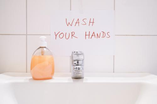 wash your hands handwritten notice above bathroom sink sign washing soap hygiene basin hand basin vanity basin washbowl washbasin washroom restroom clean