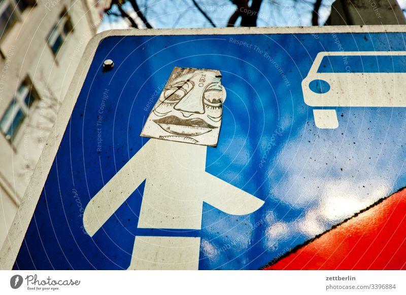 traffic sign on the outside Berlin grimace Face illustartion Deserted Schöneberg Play street Town Copy Space urban alienation Road sign Addition