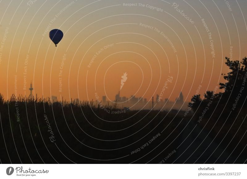 Balloon at sunrise over Frankfurt balloon hot-air balloon captive balloon aviation Flying Driving Transport Adventure free time experience Airplane Colour photo