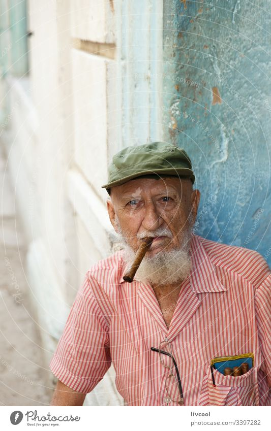 old grandfather smoking , havana - cuba ancient hat cigar cap bonnet smiling beard man people portrait grizzly la habana caribbean island street smile old man