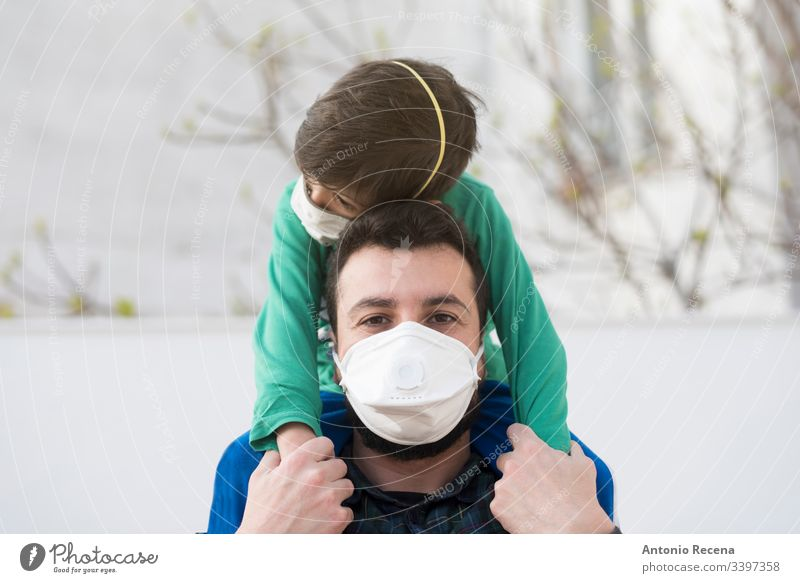 father and son with medical mask contagion contagious one person disease epidemic face mask illness arab middle eastern mers coronavirus man protect protection