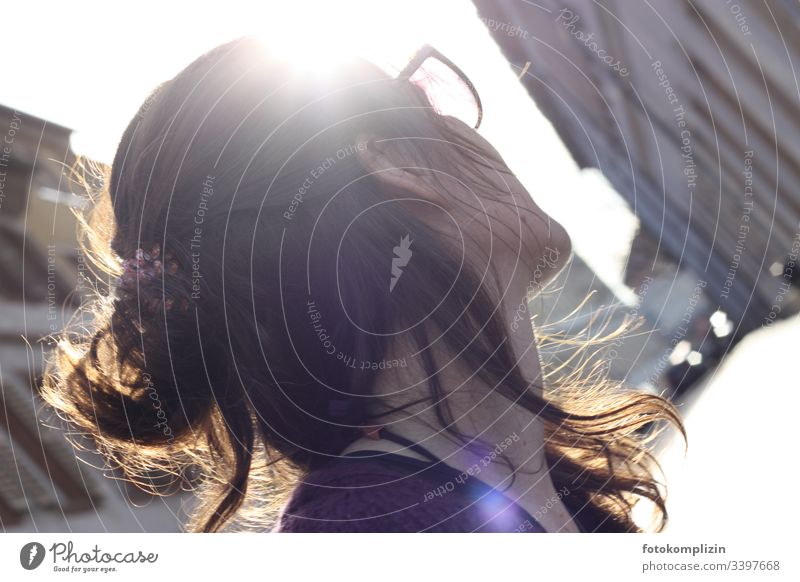 Profile of a woman backlit looking into an alleyway Woman Looking away Observe City life Wait out Think hairstyle Skyward Optimism expect expecting Outdoors