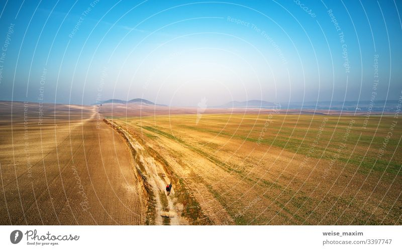 Aerial view of a ploughed agricultural field. Field path through farmland panorama Agriculture Street sunny Natural Farm Rural Antenna Environment attachable