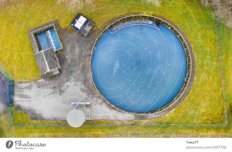 a small wastewater treatment plant in winter from above bad good dirty clean drinking water toilet water cleaning urin feces rubish water plant