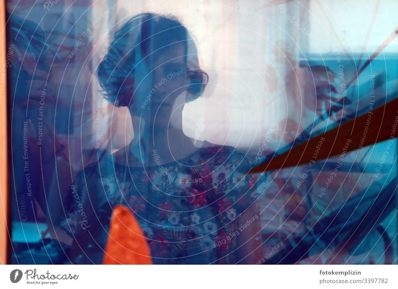Portrait of a woman in blue and multilayered reflections Personality Expectation Emotions Dream Earnest feminine Calm Identity Moody portrait thoughts Discern