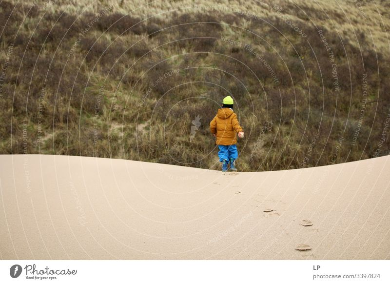 Boy running on sand dunes Sand Sandy beach Dune Vacation & Travel Beach dune Exterior shot Desert resilience difficult times Optimism Determination Brave Career