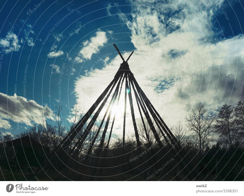 reserve Tee Pee Scaffolding Joist Tent Framework Silhouette out Sky Clouds Sun Sunlight Back-light Simple Native Americans trees