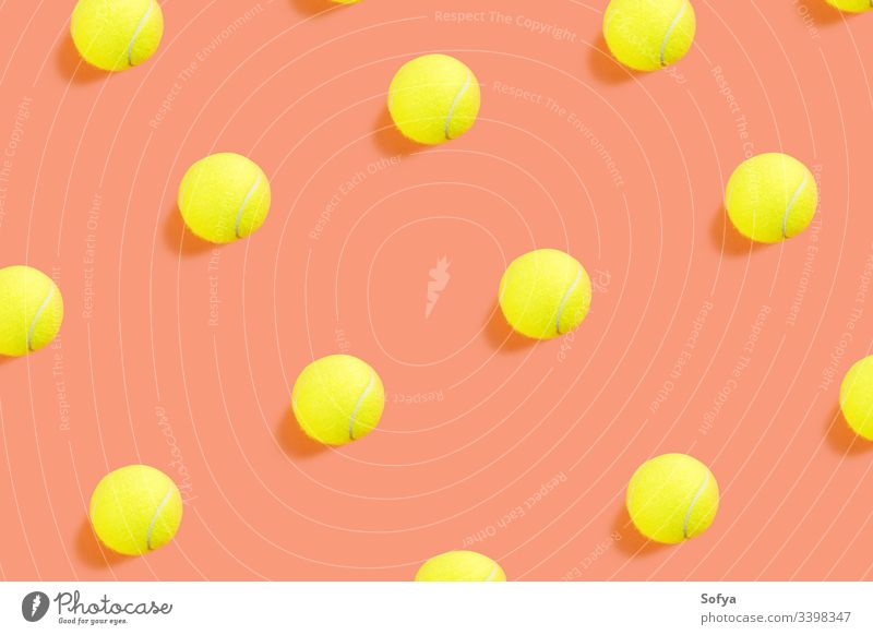 Yellow tennis ball pattern on orange coral background competition color concept top view equipment flat lay racket sport yellow trendy play teaching game match