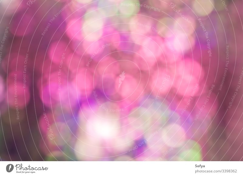 Abstract blur sequin dress color bokeh light background. Pink and green shades soft wallpaper shiny design circle glowing effect bright beautiful disco abstract