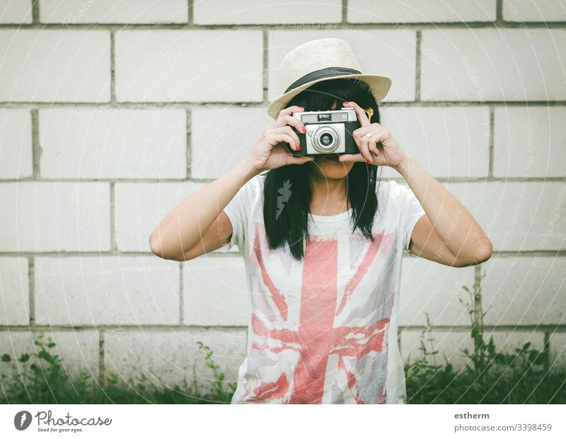 Portrait of young woman with camera photo photographer beautiful beauty european shoot selfie fun focus summer holidays expression fashion style femininity