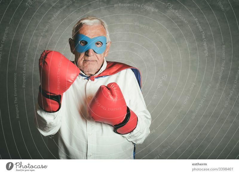 Super grandpa, senior man dressed as a superhero grandfather power victory retired pension people Senior gentleman retirement expression attitude mask disguise