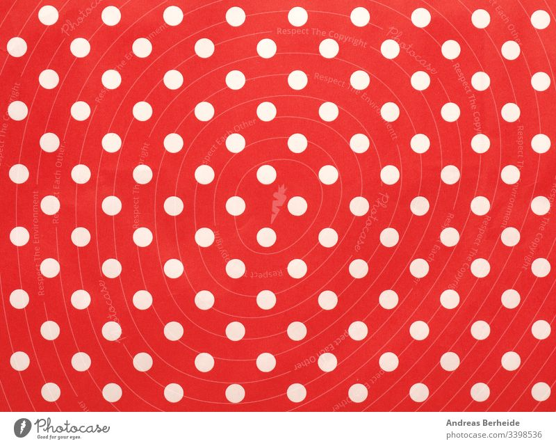 Paper texture with white dots on red using as background image polka dot textured simple material detail holiday row cover modern wrapping composition fashion