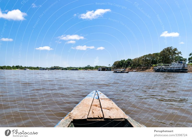 Beautiful view over the waters of the Amazon River in a boat amazon america iquitos peru tropical river rainforest background jungle landscape nature reflection