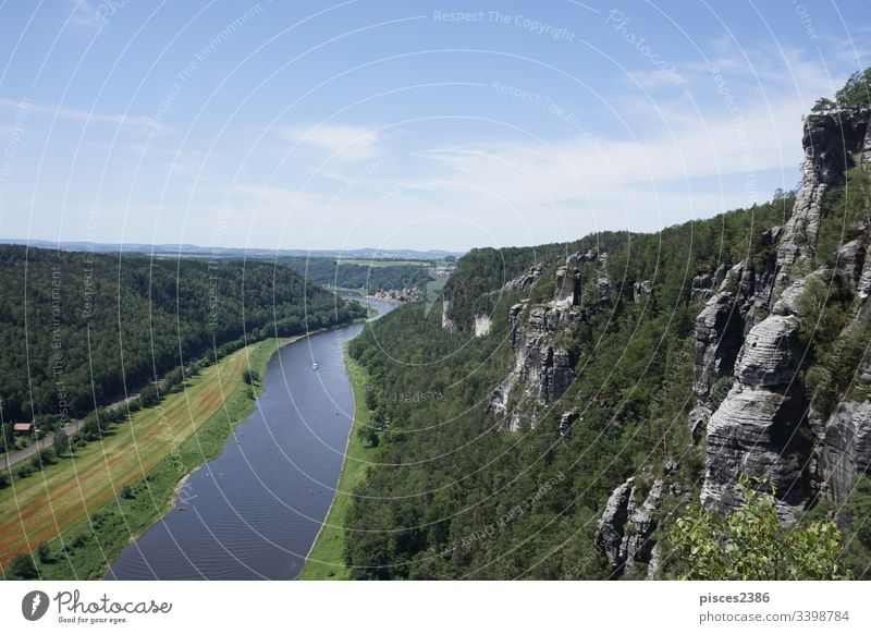 View over the Elbe river and the cliffs of Saxon Switzerland to Stadt Wehlen germany europe bastei elbe nature landscape view beautiful forest mountain
