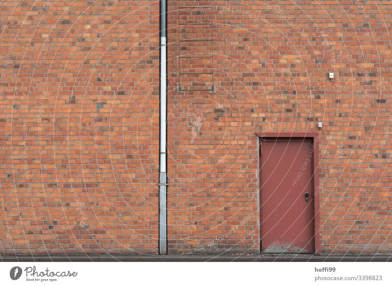 Red brick facade with downpipe, door and ladder clinker facade brick wall red brick Downspout Door Symmetry Window Venetian blinds Closed Warehouse Depot