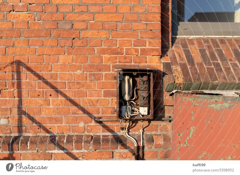 Telephone - old station to red brick wall Telecommunications Connection Receiver Cable To talk Old Retro Rotary dial Office Contact Old fashioned