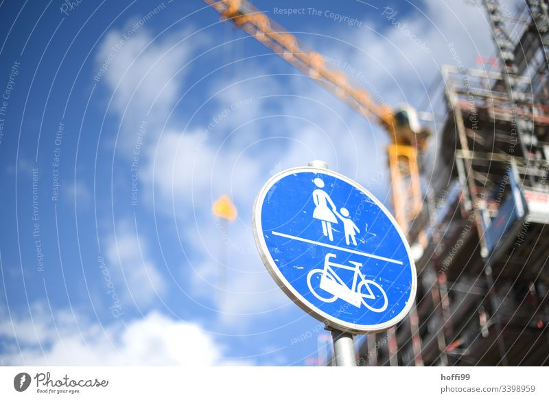 Traffic sign footpath cycle path in front of blurred crane on construction site Road sign Transport Cycle path Pedestrian Road traffic Traffic infrastructure