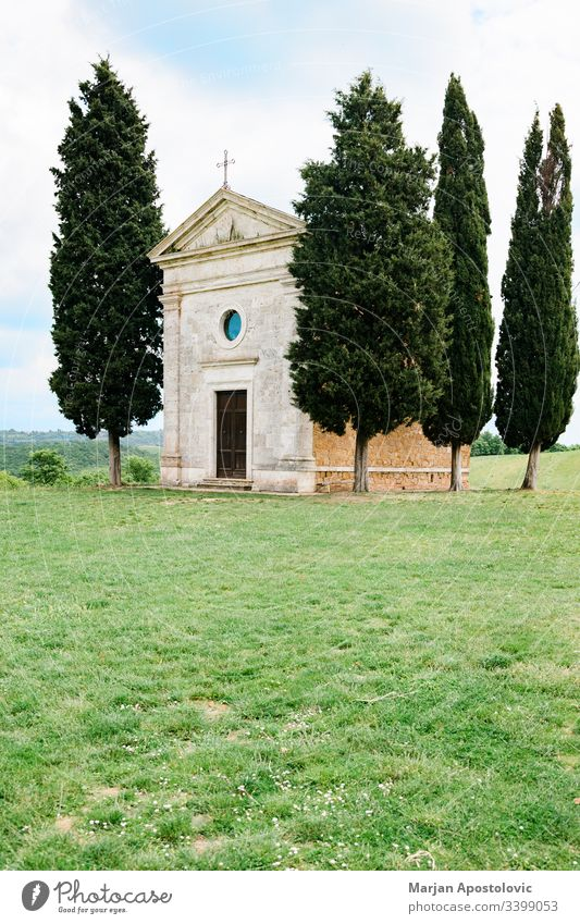 Famous church in the fields of Tuscany, Italy ancient architecture beautiful building cappella catholic chapel christian countryside cypress europe faith famous