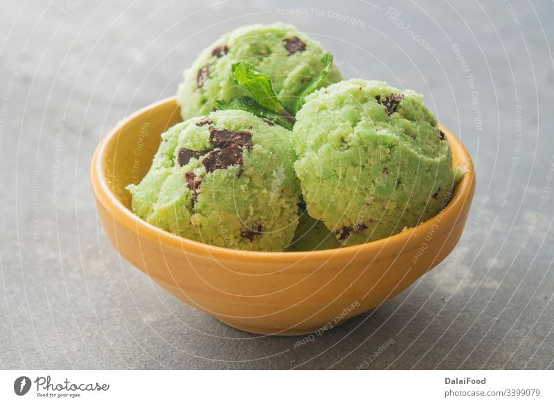 Ice cream with mint and chocolate chip background ball bowl close up creamy dairy dessert flavor flavour food frozen gelato green homemade ice ice-cream