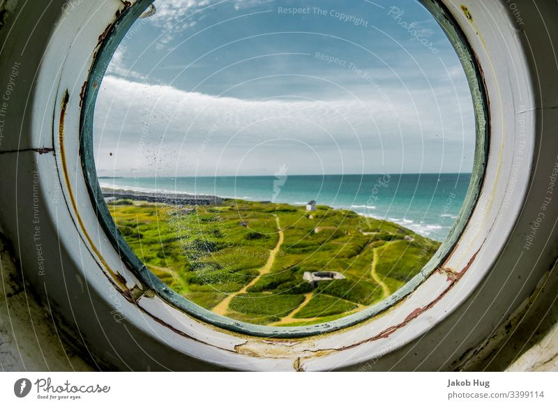 View from the round window of a lighthouse to the coast of Denmark Window Airplane Sky Mirror aviator Vantage point farsightedness Clouds Landscape Porthole