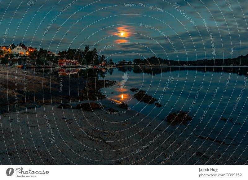 Moonlight reflected in the water in a lake in Norway Coast reflection Reflection in the water sunset smooth smooth water surface Ocean Water Landscape Lake