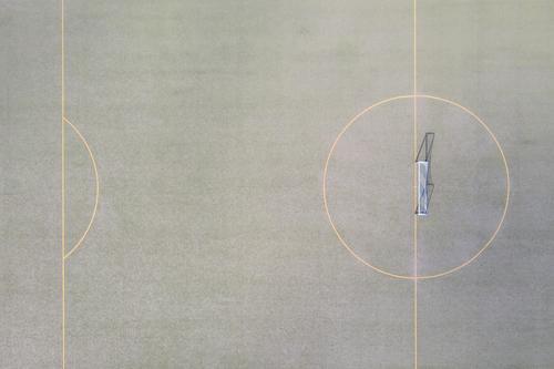 a soccer field goal from above soccer goal lines sport sport place green small soccer field grass sun shadow sports