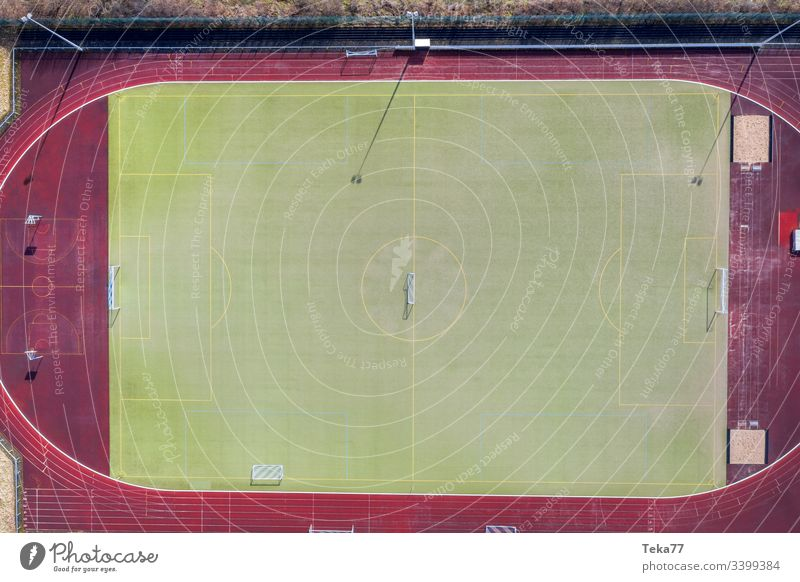 a soccer field from above soccer field goal soccer goal lines sport sport place green small soccer field grass sun shadow sports running track ash fieldl
