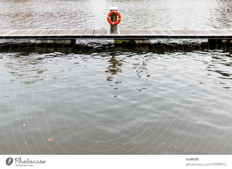 Life belt on jetty at landing stage Footbridge Jetty Water Lake Wood Watercraft Nature Harbour Calm Coast Moody Morning Reflection Maritime Surface of water