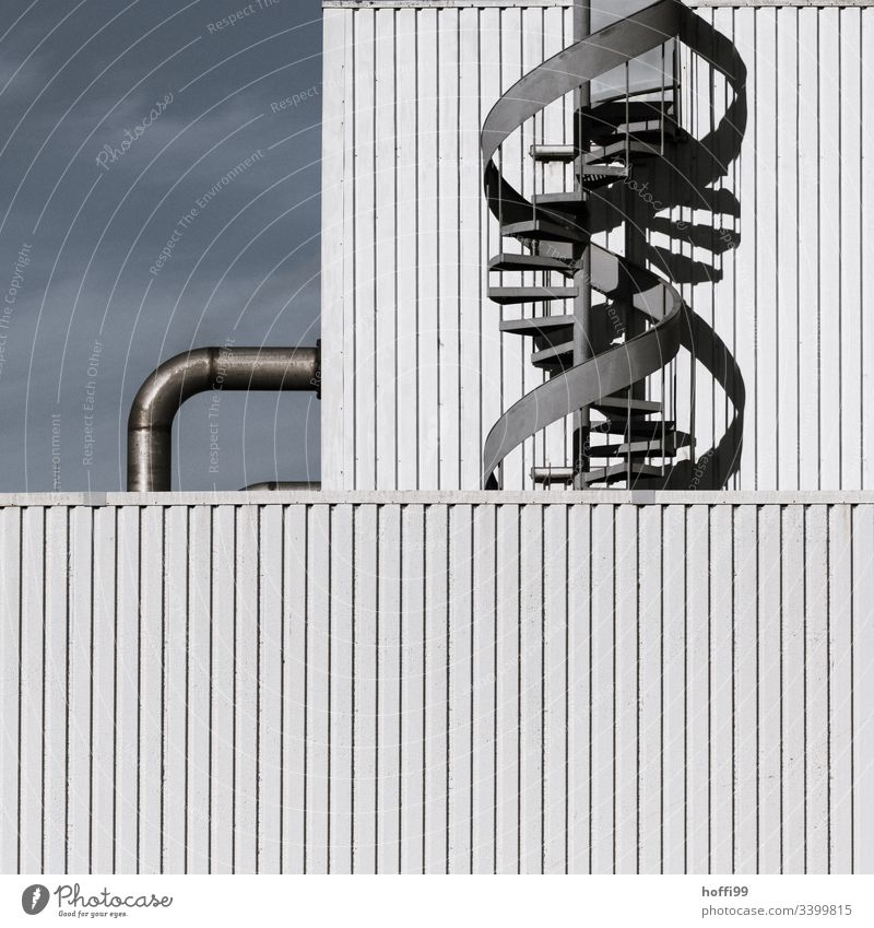 Spiral staircase with pipeline on industrial facade Emergency exit Winding staircase Facade Steel Industrial plant Warehouse Stairs Industry Pipe system