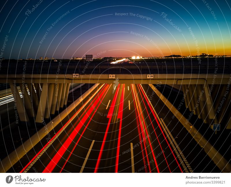 View of highway at sunset long background freeway movement travel headlight dark fast transport exposure red traffic car night motorway transportation motion