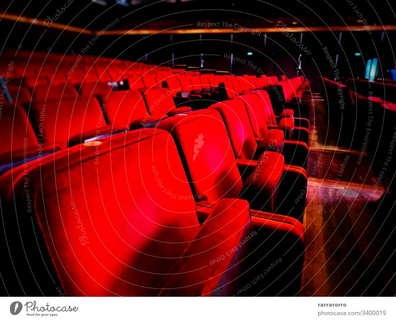 a row of empty red velvet armchairs inside an auditorium. Seat Chair Movie Theater In A Row No People Theatrical Performance Red Empty Entertainment Indoors
